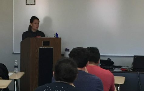 (Photo courtesy of Bettina Plesnitzer) Speaker Maryann Miller tells the story of a family member's struggle with opioid addiction during a lecture Nov. 3 in P.E. classes.