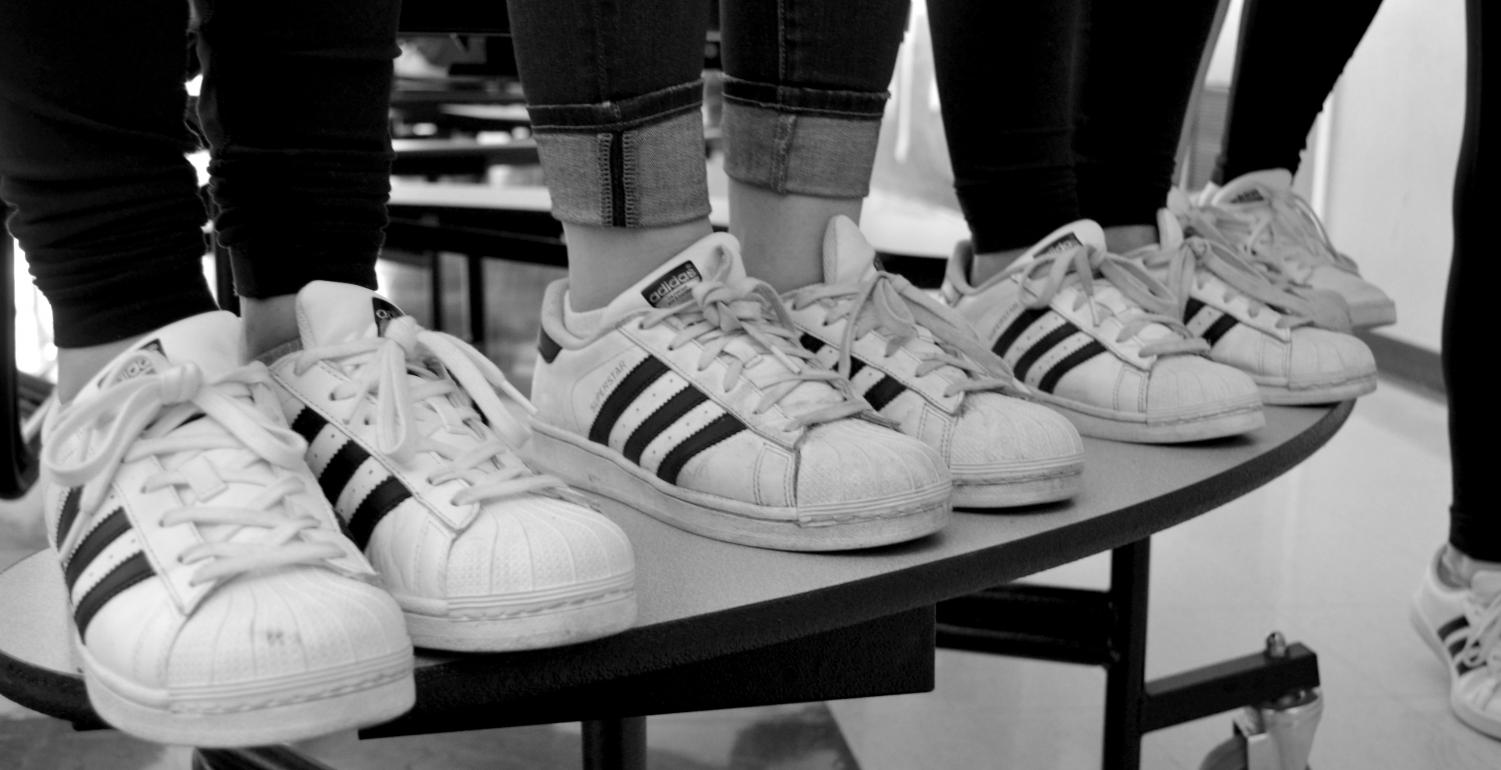 """(Photo by Ally Schachtel) Teen girls wear similar Adidas superstar sneakers because they are considered  """"trendy"""" and are in style throughout the West Essex community."""