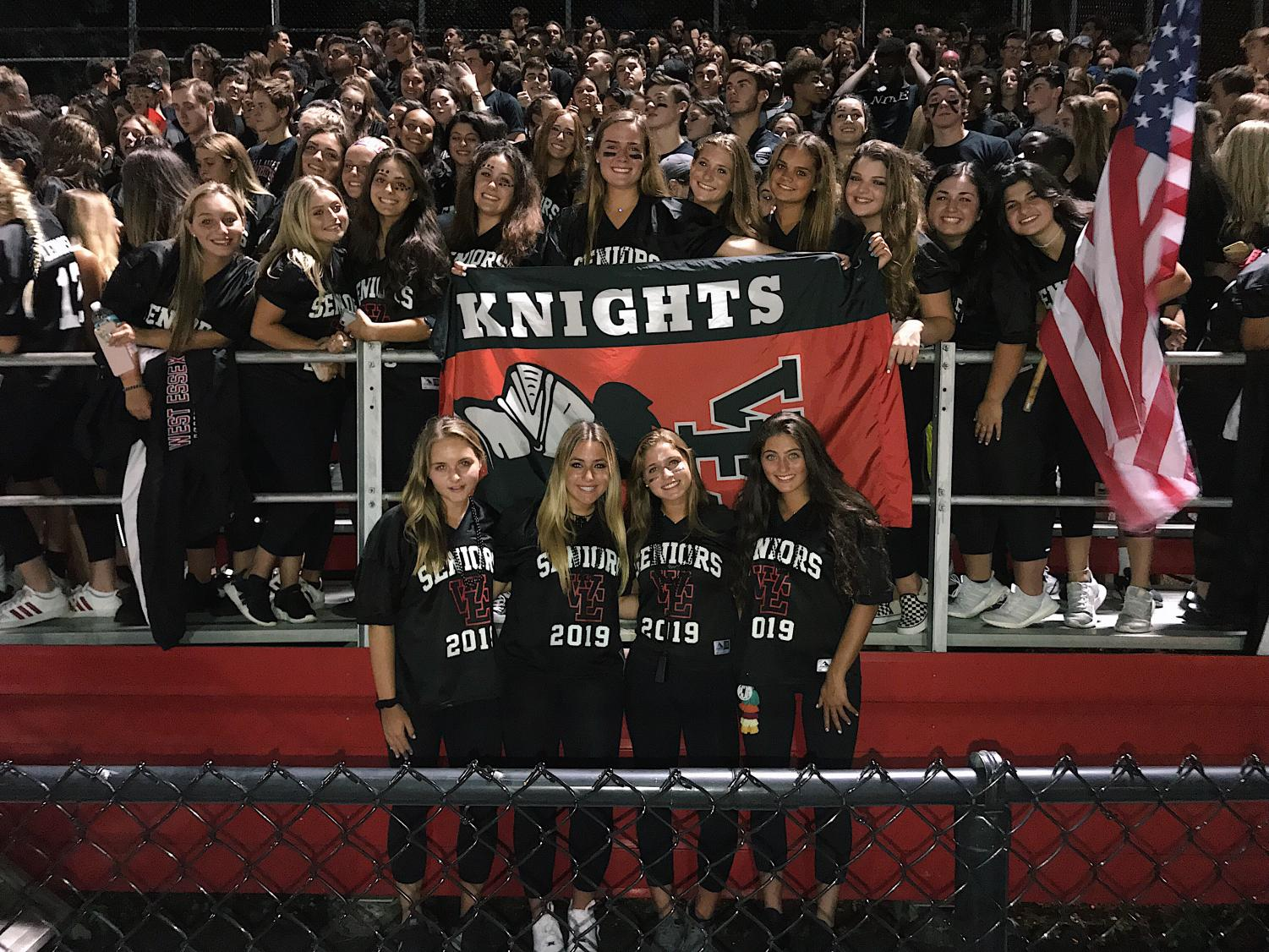 Students lead the fan section, flag in hand.