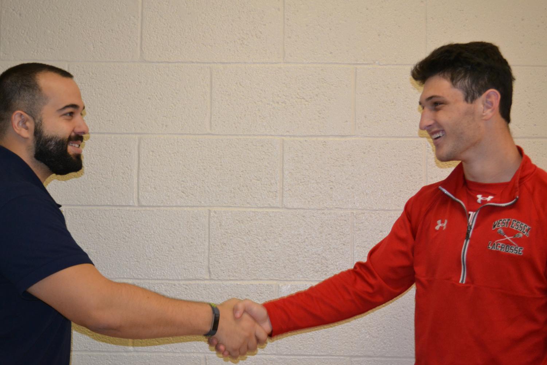 Italian teacher Michael Micucci and junior Tommy Drago shake hands.