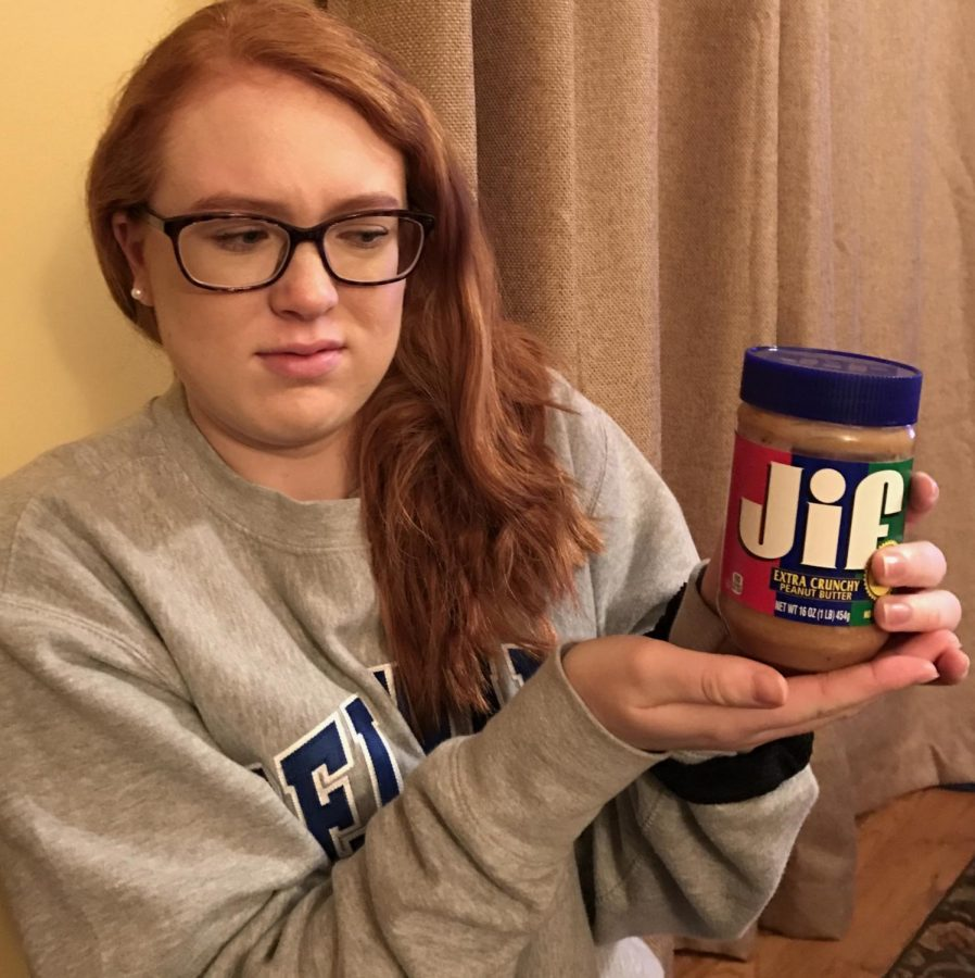 Megan+looking+at+peanut+butter+in+disgust.+