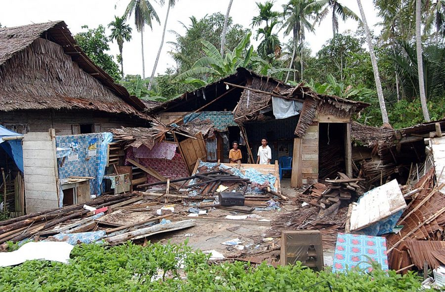 Indonesia+Earthquake+caused+a+great+deal+of+destruction.+This+photo+shows+a+man+standing+before+his+home+after+it+was+obliterated.