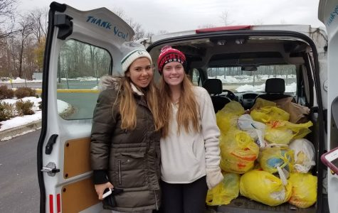 Cooking for a Cause club president Gillian Wolf and sophomore Madison Trewhella collected turkeys and canned goods on Nov. 18.
