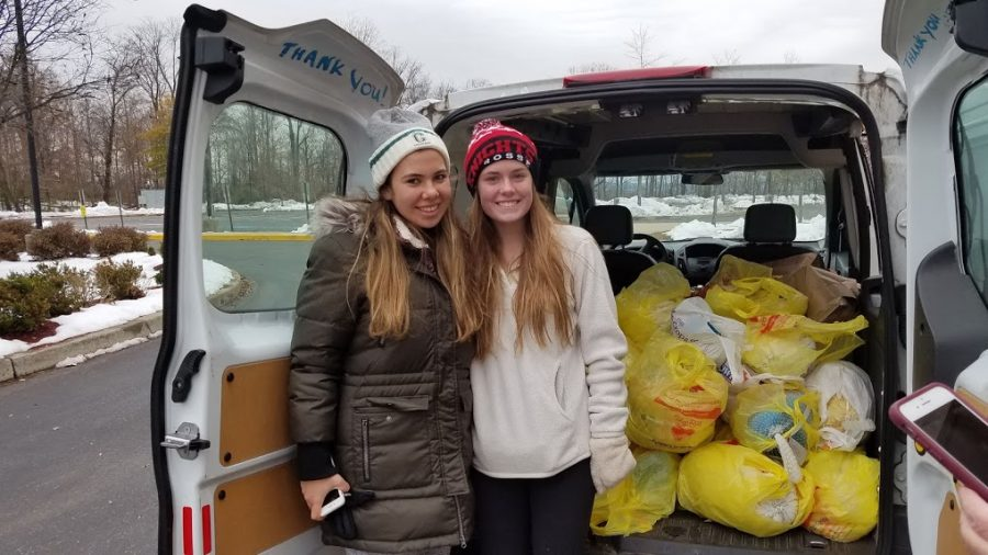 Cooking+for+a+Cause+club+president+Gillian+Wolf+and+sophomore+Madison+Trewhella+collected+turkeys+and+canned+goods+on+Nov.+18.