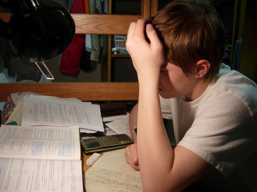 (Photo courtesy of Paul Fisher (CC BY-SA 2.0)) Frustration sets in for student as he waits until nighttime to cram his work in.