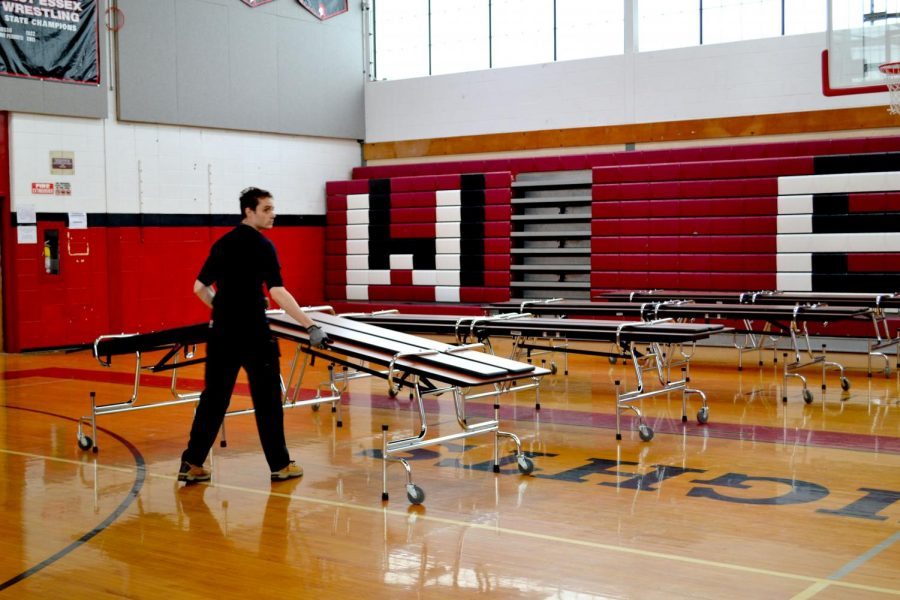 Custodian Steve Siragusa quickly setting up for lunch.