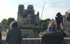 Onlookers witness the damaged exterior of Notre Dame cathedral in Paris on April 16.