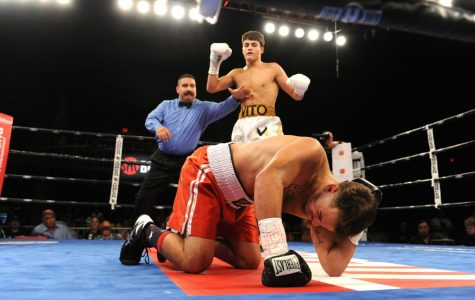 (Photo By: Emily Harney/Banner Promotions ©2019) Senior Vito Mielnicki pauses after knocking down his opponent in Midland, Texas, on Sept. 20.