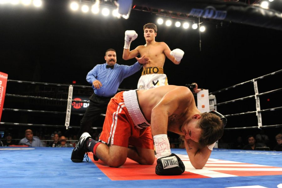 %28Photo+By%3A+Emily+Harney%2FBanner+Promotions+%C2%A92019%29+Senior+Vito+Mielnicki+pauses+after+knocking+down+his+opponent+in+Midland%2C+Texas%2C+on+Sept.+20.