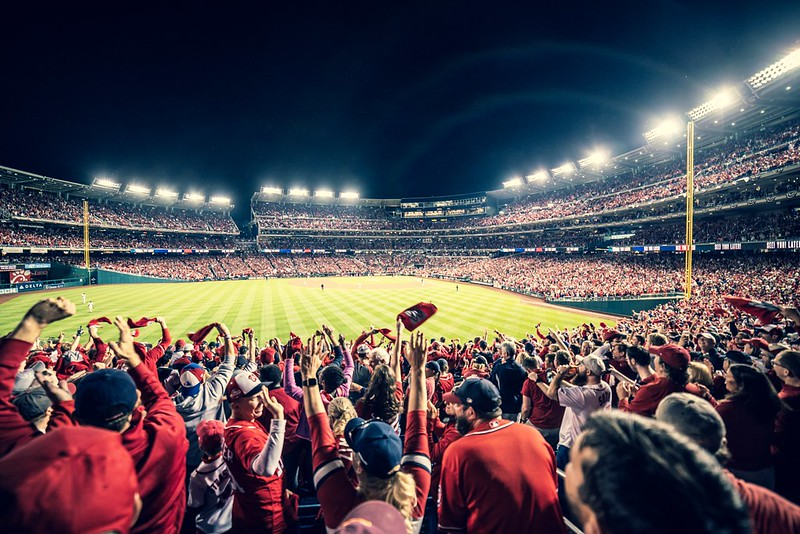 The Washington Nationals crowd waves their team towels in support.