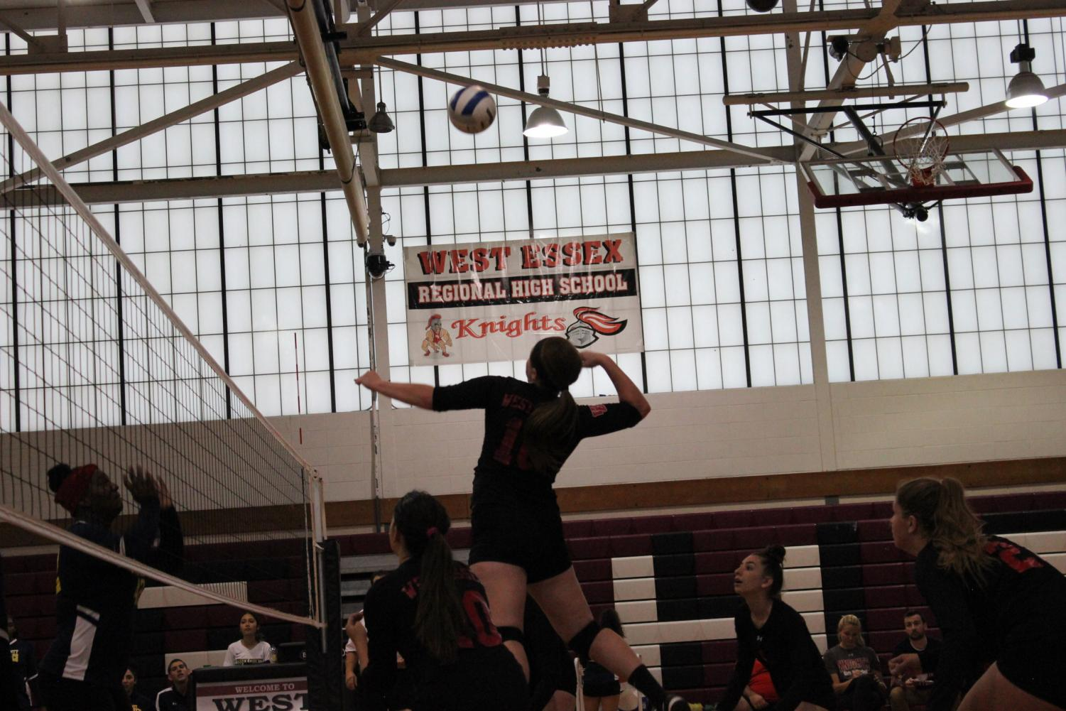 (Photo courtesy of Zoe Offir) Senior Jess Coia spikes during a home game at West Essex.