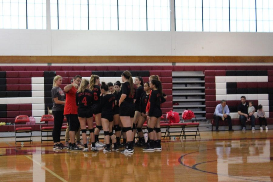 %28Photo+courtesy+of+Abby+Flynn%29+Volleyball+team+huddles+up+with+Jess+for+one+of+her+last+games+as+a+senior.+