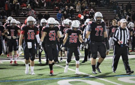 Football captures fourth straight conference title