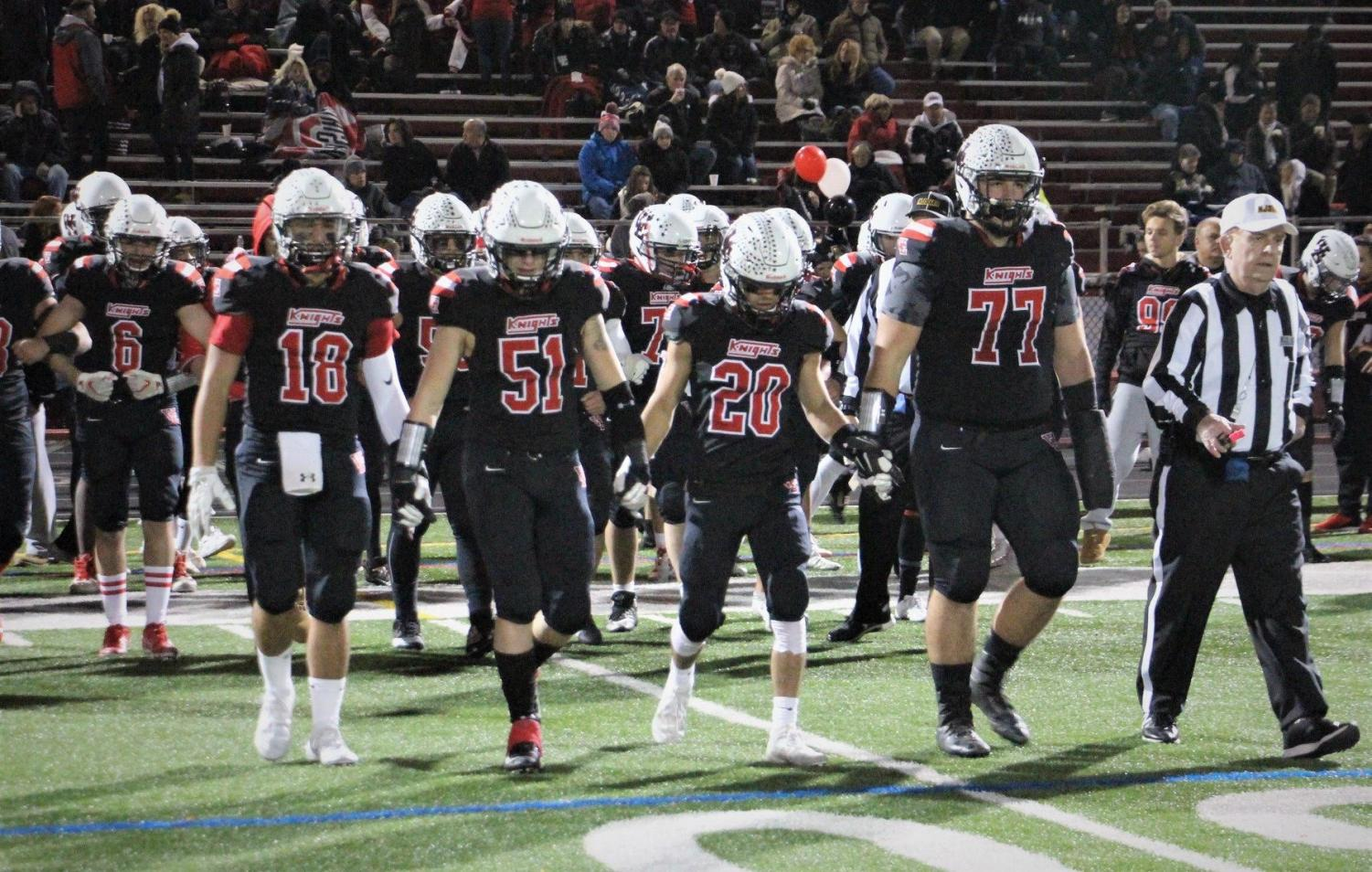The Football Knights captains take the field at the West Side game on Nov. 1. West Essex clinched their fourth straight conference title after toppling West Side 23-20.