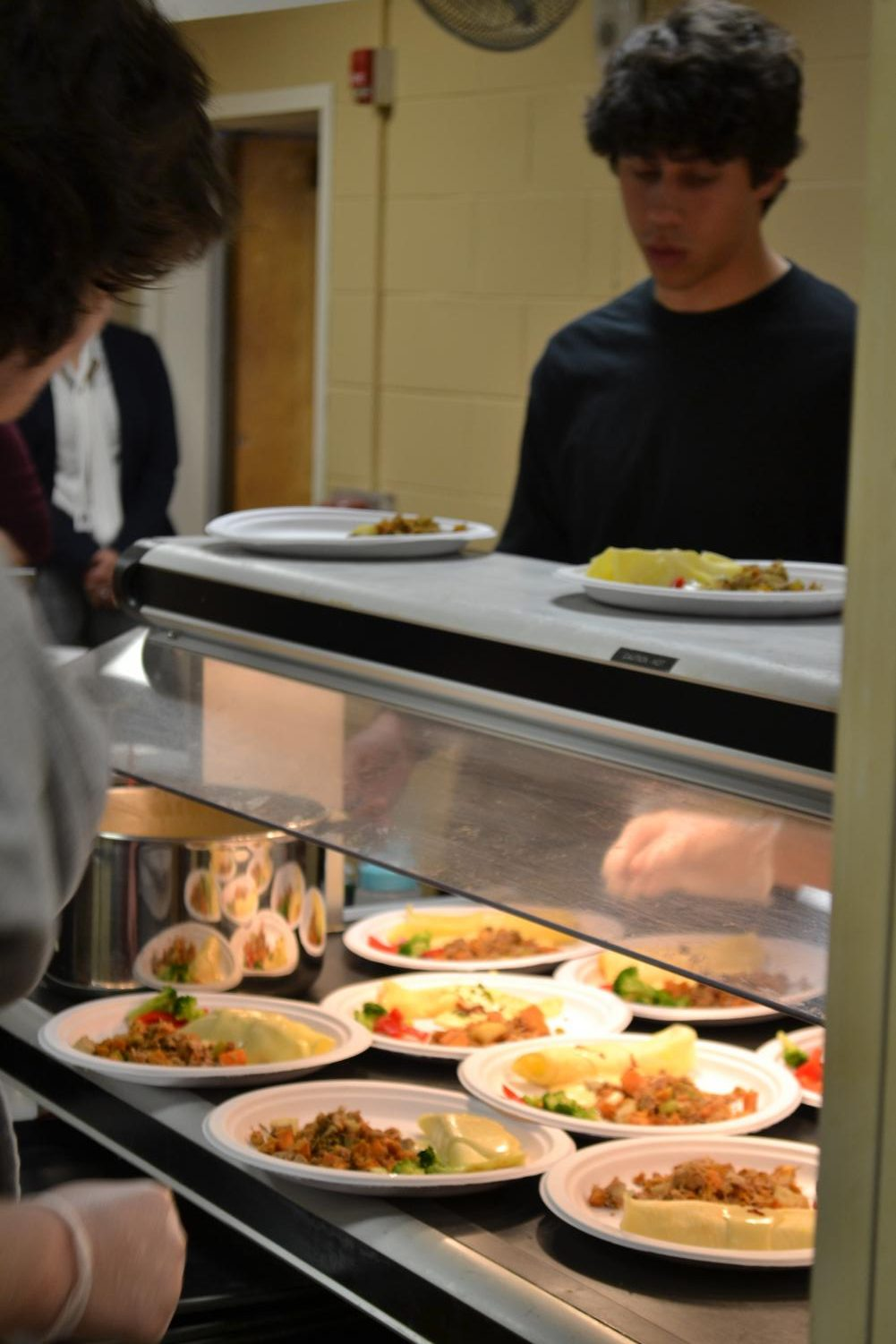 (Staff Photo) Culinary II students worked hard on providing senior citizens quality food.