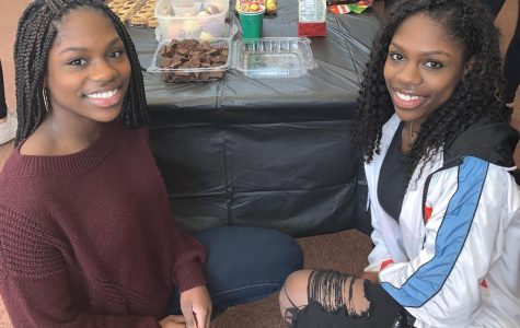 Juniors Morgan (left) and Arianna Lee (right), founders of the new Multicultural Club, helped run the group's first event, a Feb. 4 luncheon.