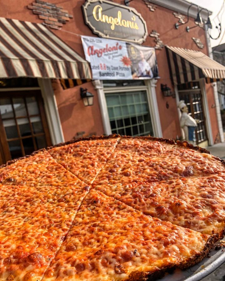 Famous Thinny Thin Pizza in front of restaurant