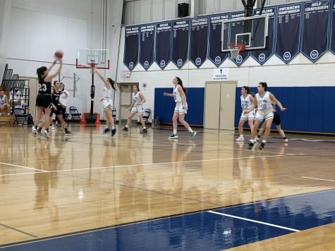 Senior Katelyn Doud (23) shoots a 3-pointer Thursday, Jan. 5 against Mount St. Dominic Highschool. The school administration's plan to bring back winter sports is to break it up into 3 sub-seasons to give each athlete a fair season.