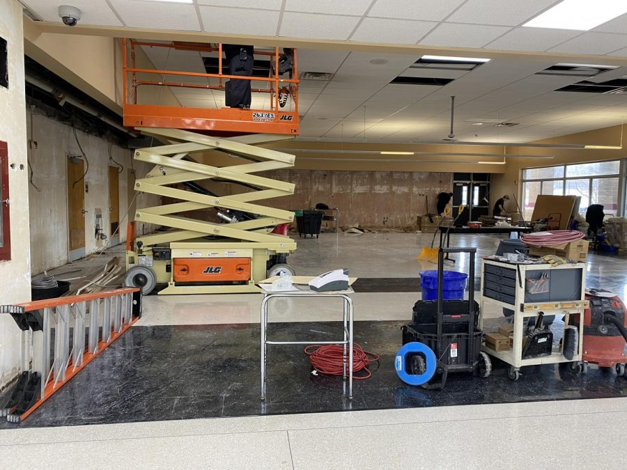 Custodial staff work on maintenance updates to the cafeteria at the high school.