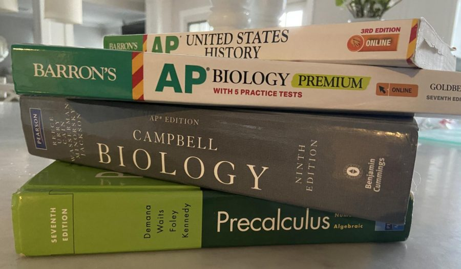 As AP exams approach, students stack up on studying material and pray that College Board goes easy on them.