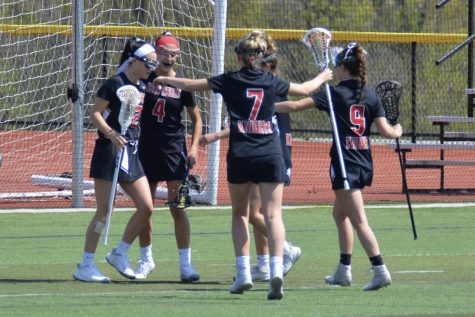 Lady Knights celebrate after a goal, something they hope to do a lot on Saturday!